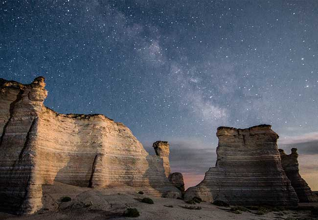 Visit Monument Rocks in Kansas at night and you'll have a chance to see the Milky Way on a starry night.
