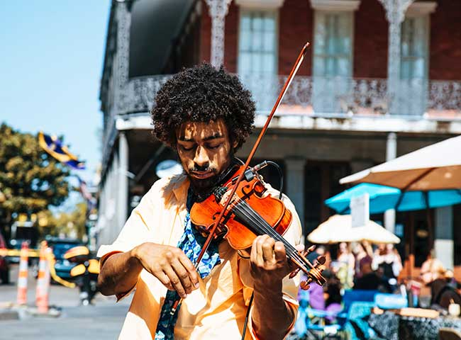Be sure to check out the French Quarter and lisen to jazz music playing when you visit New Orleans, Louisiana.