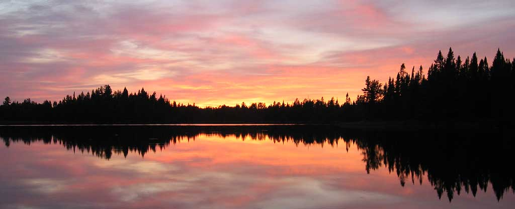 Minnesota is well known for its many scenic lakes like Pose Lake at sunset.