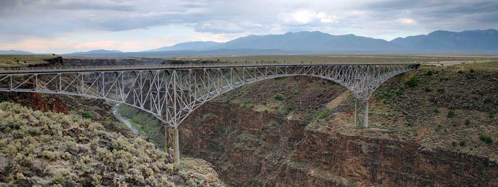 Travel across the Rio Grande river on the Rio Grande Gorge bridge.