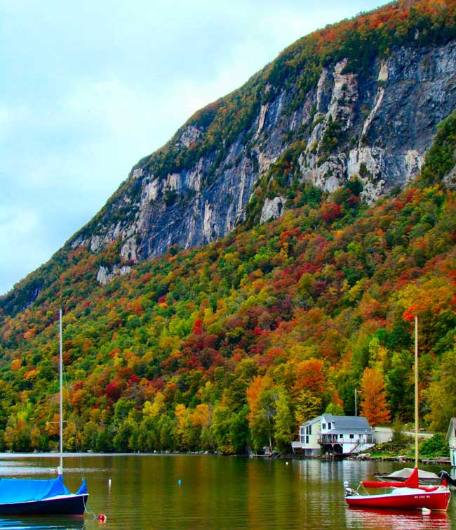 Be sure to see the beautiful mountains and lakes like Lake Willoughby when traveling through Vermont.