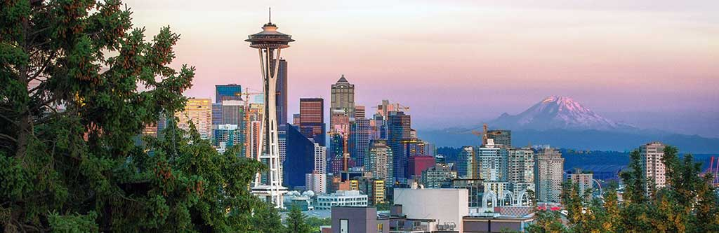 Seattle in Washington state is easily recognizable by the iconic Space Needle and Mt. Rainier nearby.