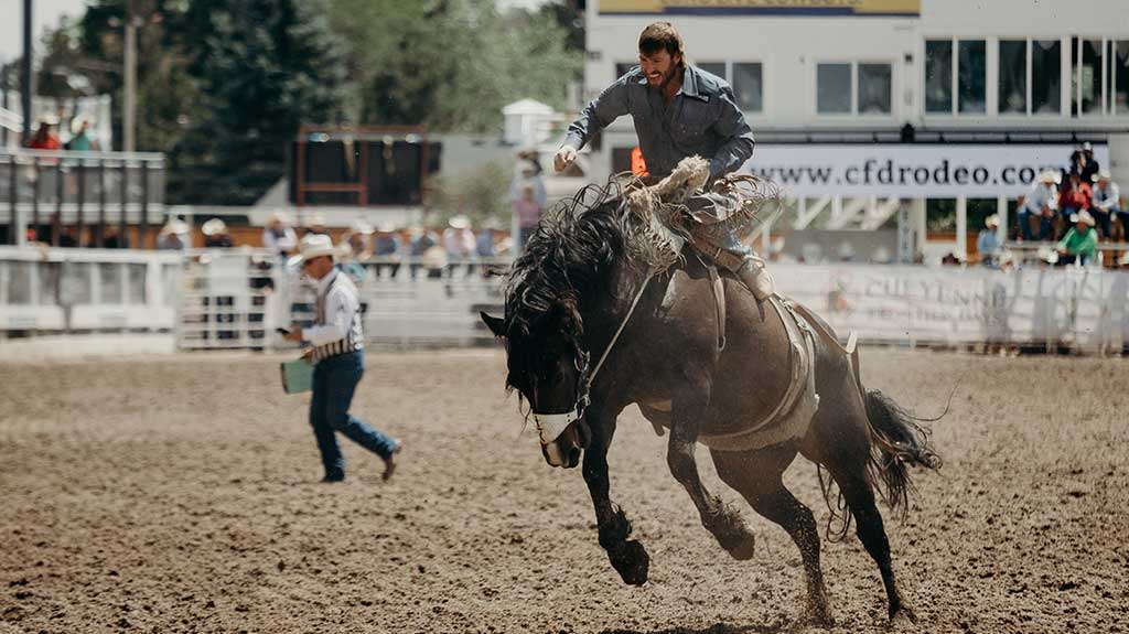 Visit a rodeo event in Cheyenne, Wyoming.